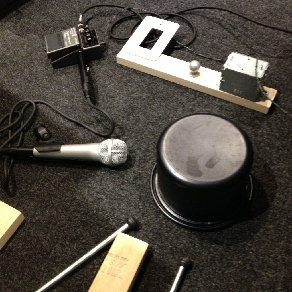 microphone and mallets around a cooking pot